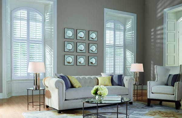 white wood shutters for arched windows in a living room